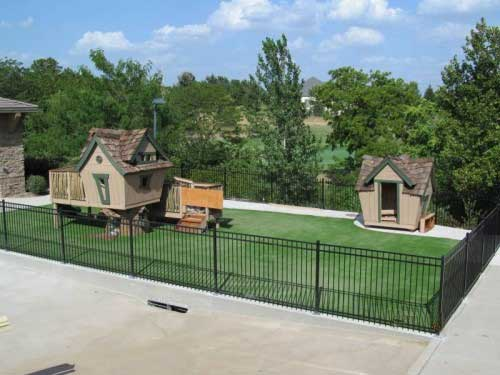 Tree fort on artificial playground turf in St. Louis