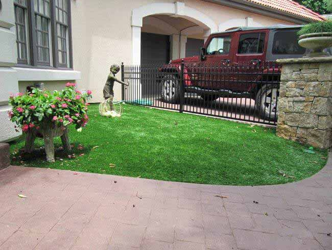 Artificial landscape grass next to the front walkway in Missouri
