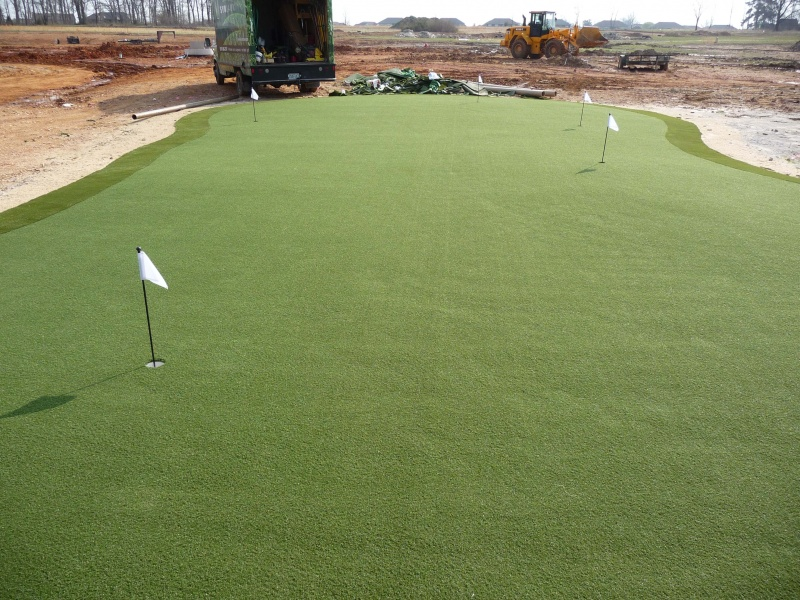Construction of an artificial turf putting green