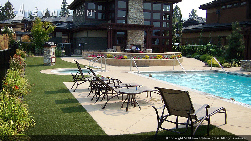 Hotel swimming pool surrounded by artificial turf patio in Missouri