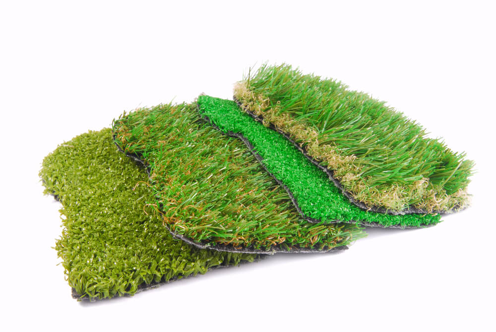 Types of artificial turf samples overlapping on white background